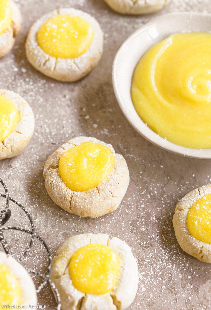 Lemon Curd Shortbread Cookies! Homemade lemon curd dolloped onto a batch of gluten free shortbread cookies! #lemoncurd #shortbread #glutenfree #snack