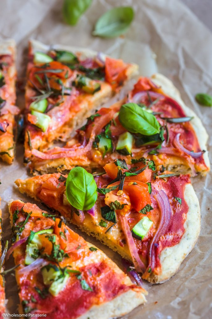Gluten Free Pizza! Simple homemade pizza base topped with fresh, bursting with flavour veggies + herbs! #glutenfreepizza #glutenfree #pizza #vegetarianpizza