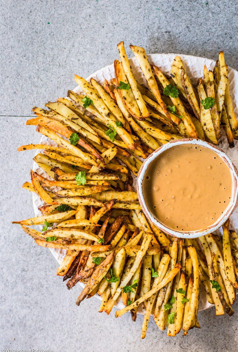 Roasted Herb Fries + Peanut Butter Dip! Crispy oven fries served with an easy peanut butter dip! #fries #peanutbutter #hotchips #lunch