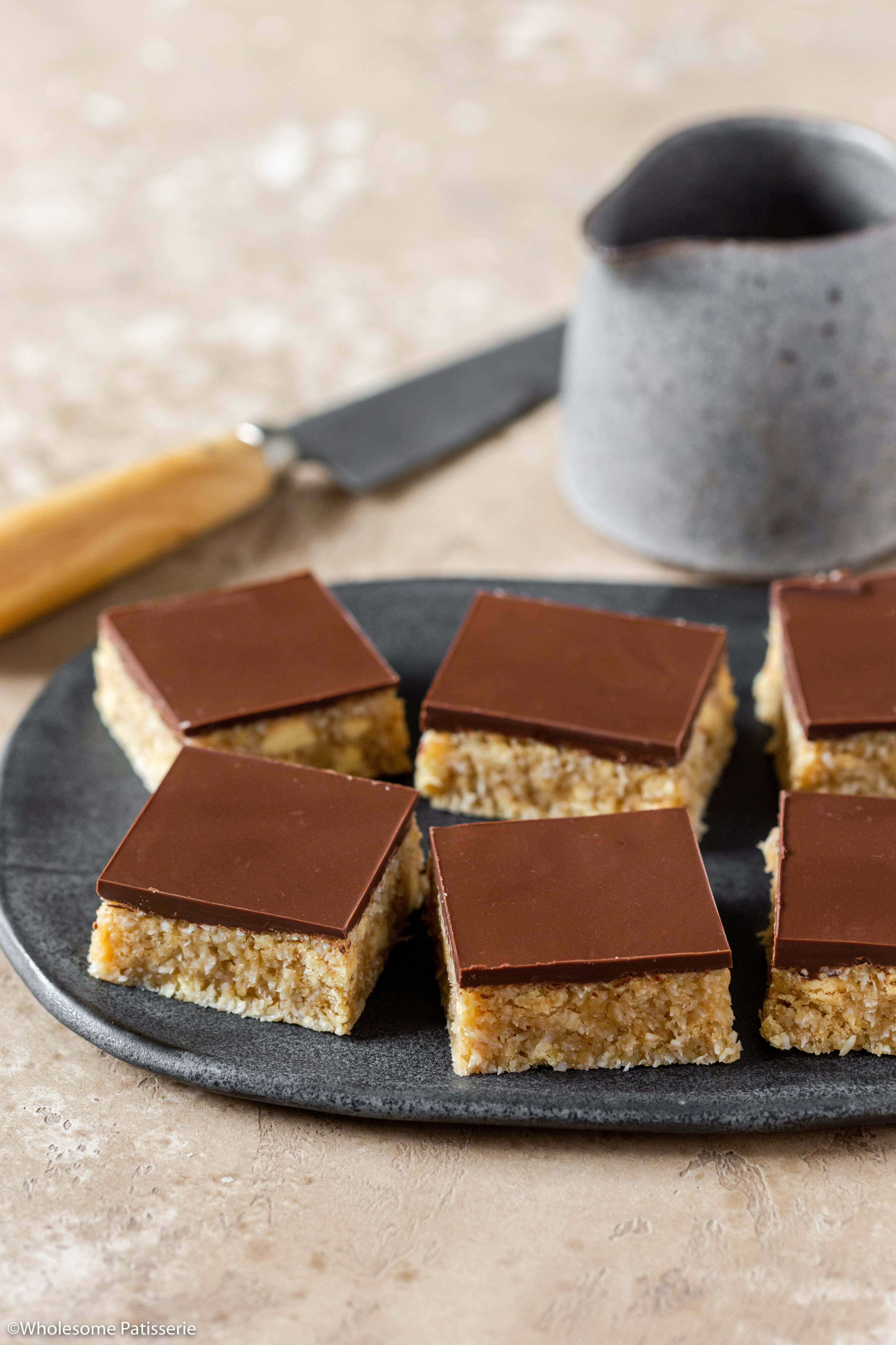 Cheat's Caramel Slice (Dairy & Gluten Free)! Homemade dairy free caramel sauce mixed through a biscuit base and topped with melted dark chocolate! 2 layered caramel slice perfection!