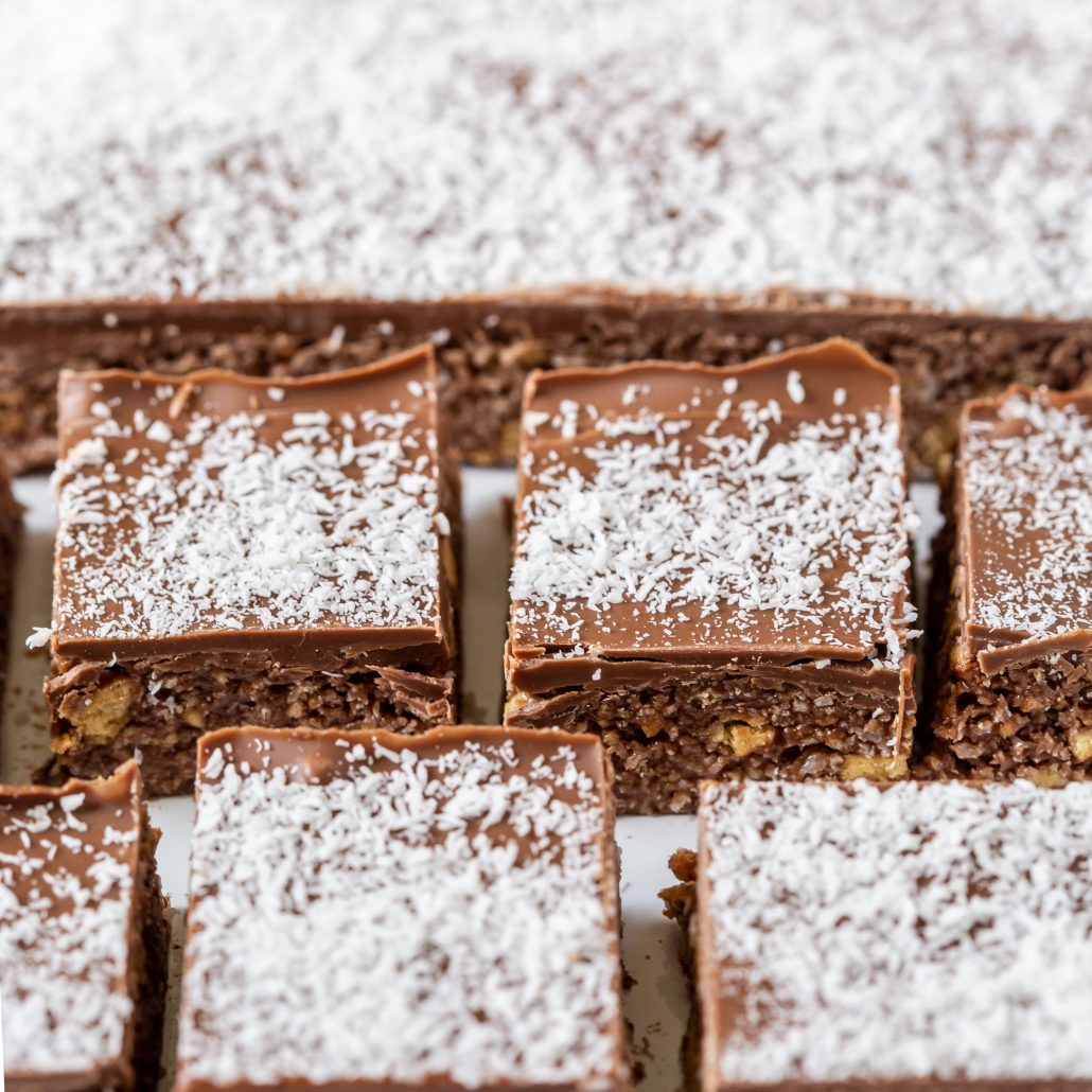 6-Ingredient Chocolate Coconut Slice! Can be created gluten free! They make for great work and school lunchbox snacks!