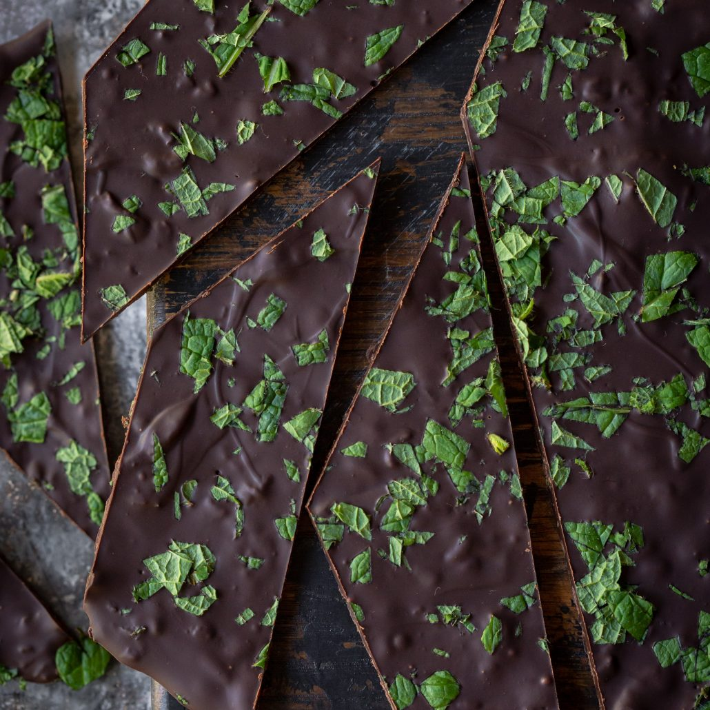 Fresh Mint Chocolate Bark! Fresh mint leaves chopped and mixed through melted dark chocolate and spread out into bark thickness. Sprinkled with more mint leaves, refrigerated and ready to enjoy! Zero mint essence needed!
