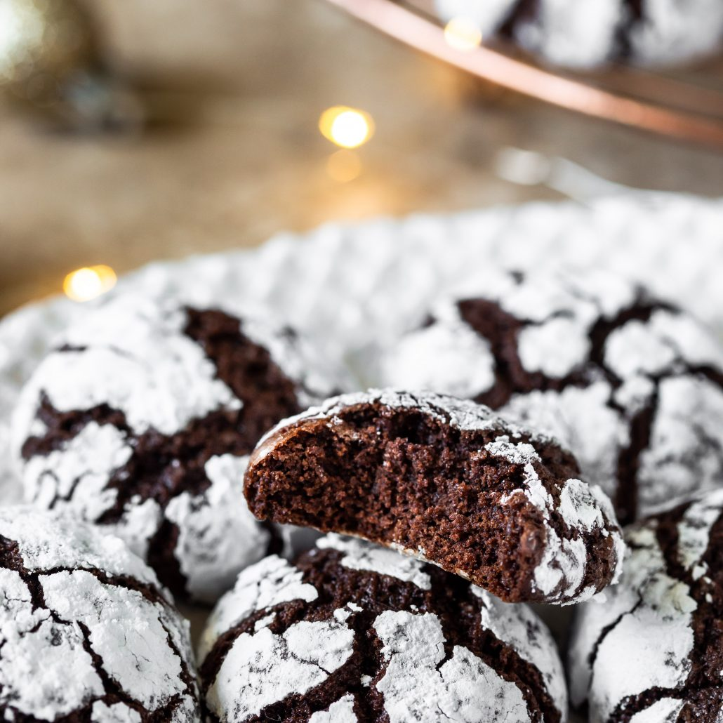 Chocolate Crinkle Cookies! Fudgy chocolate cookie dough rolled in snow white icing sugar! Perfect for your at home Christmas baking!