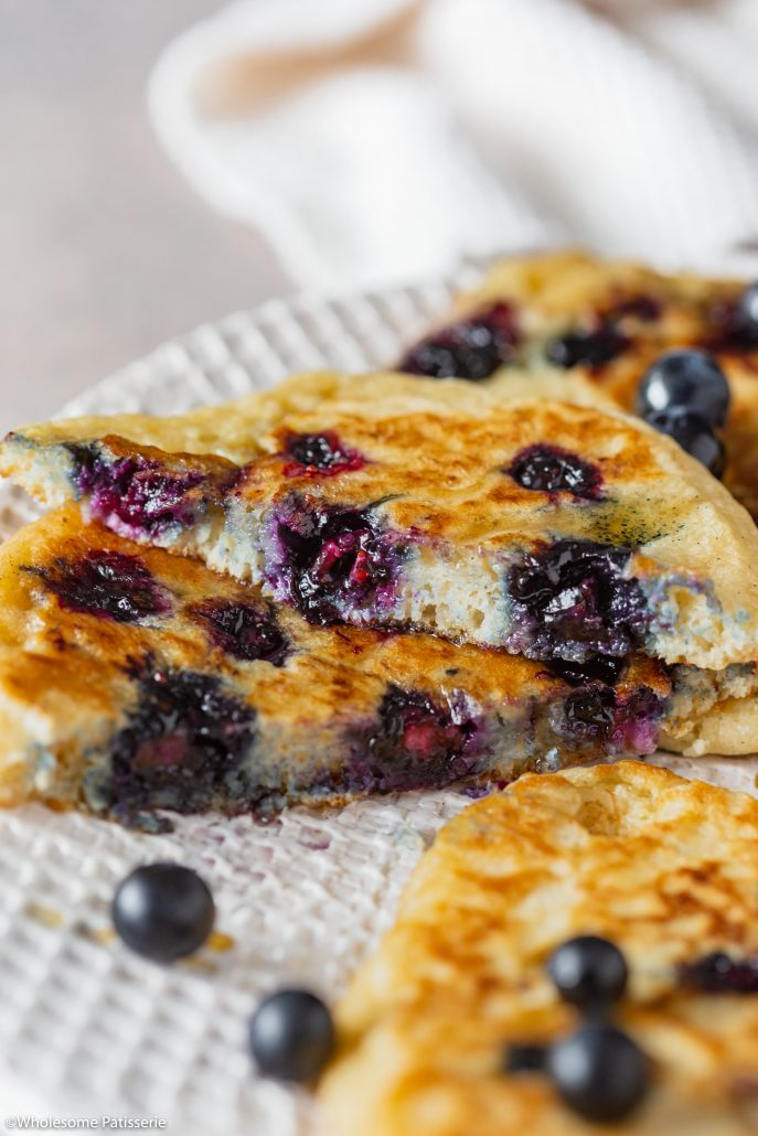 Classic Gluten Free Blueberry Pancakes! Fluffy golden and bursting with blueberries! Made using gluten free flour, your new perfect Sunday morning breakfast!