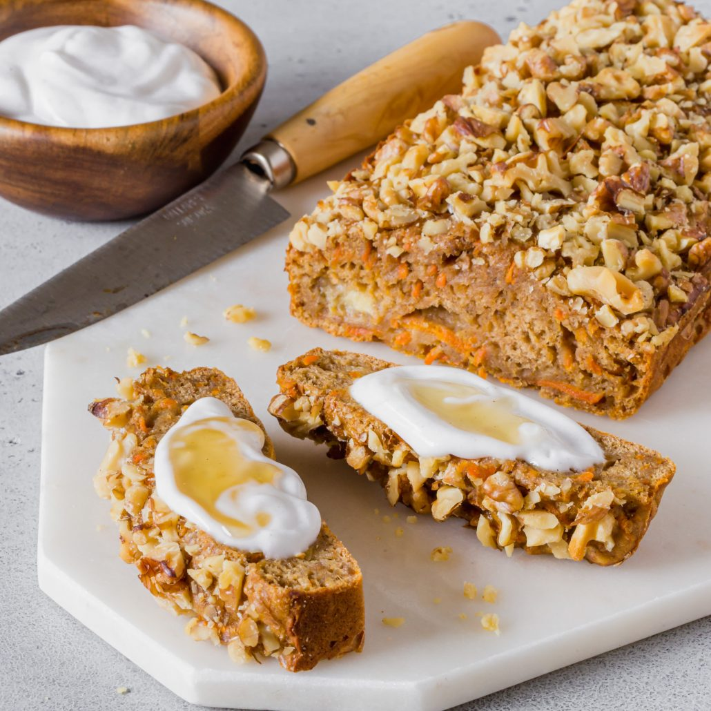 Banana & Carrot Snack Loaf! This simple and quick loaf is a beautiful blend of banana bread and carrot cake. It's smaller in height than traditional large loaves which makes it perfect for snacking. Serve with vanilla infused coconut yoghurt and a drizzling of honey!