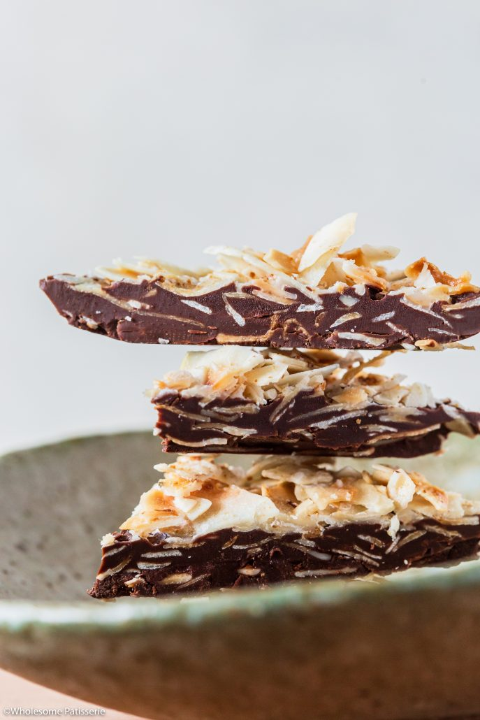 Dark Chocolate & Coconut Salted Clusters! These divine 5-ingredient clusters are utterly delicious! A melt-in-your-mouth dark chocolate base topped with toasted coconut flakes mixed with coconut oil and a little dark sugar. Finished off with a sprinkling of sea salt flakes - YUMM!!!