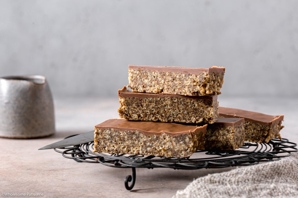 Almond & Milk Chocolate No-Bake Slice! Flavours of almond butter, maple, coconut, milk chocolate & spiced with a touch of cinnamon! Added crunch thanks to the rice puffs makes for a scrumptious chocolate snack for you and your family!