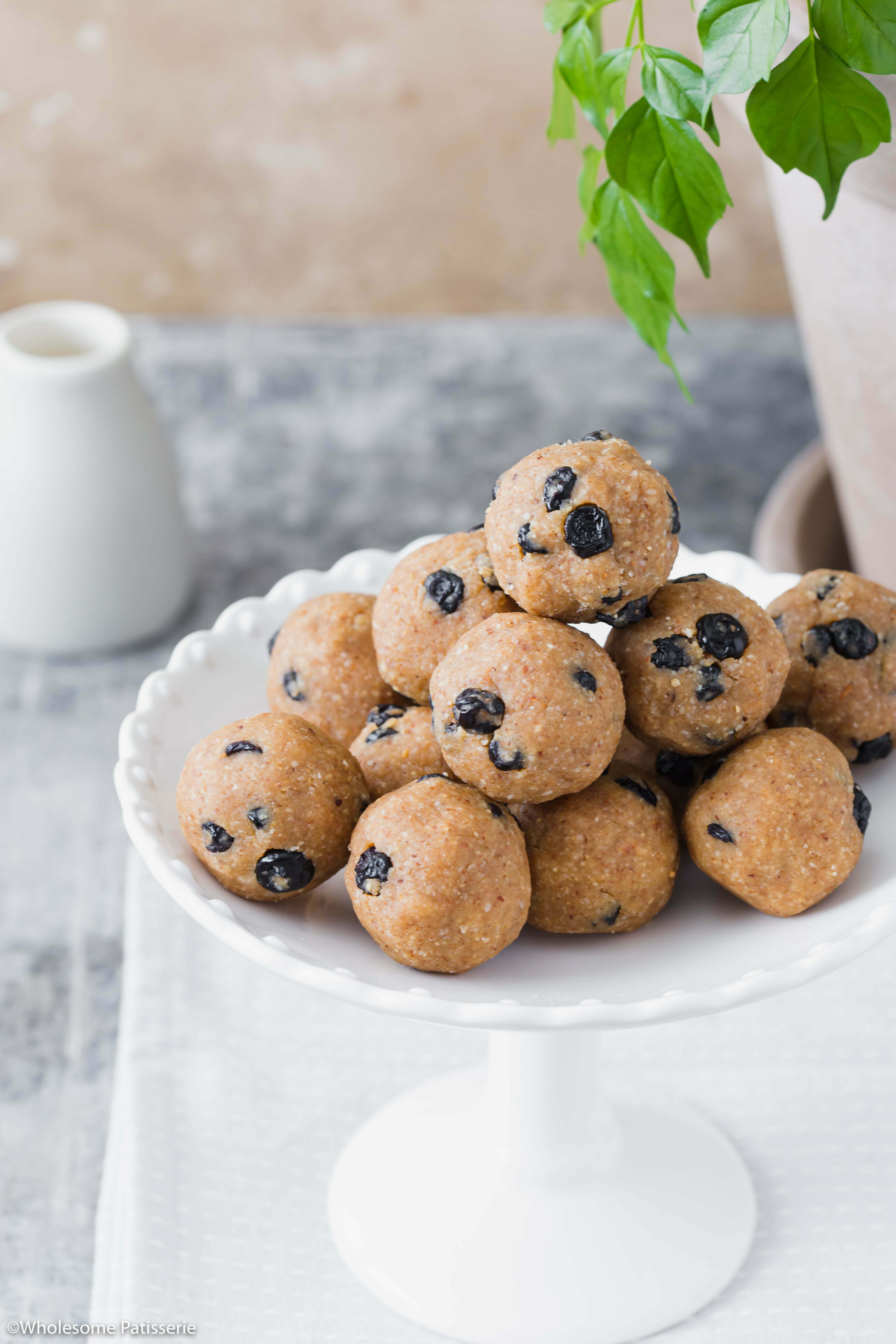 Blueberry Muffin Bliss Balls! A satisfying snack packed full of healthy fats, spiced with a touch of ground cinnamon and cardamom brings these more into baked muffin territory. Add dried blueberries and you have yourself one tasty treat!