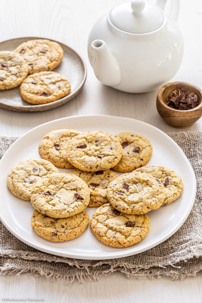 Gluten Free Chocolate Chunk Cookies! These cookies are your classic crisp on the outside, soft and gooey on the inside kind of cookie. With soft and melty chocolate chunks throughout!