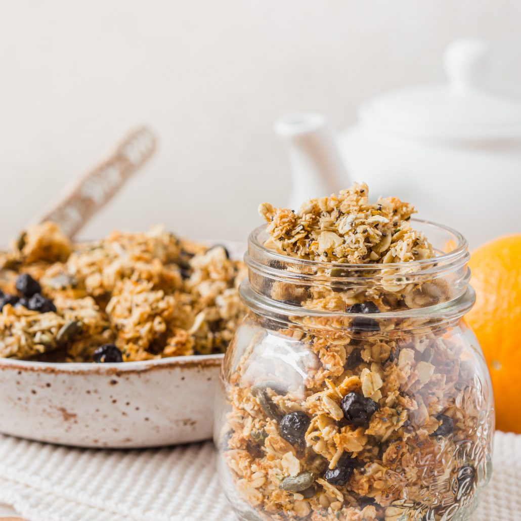 Orange & Blueberry Seeded Granola! Wholesome and flavourful orange infused homemade granola. Loaded with seeds and free from nuts! Turns out chunky which is perfect to top your yoghurt and berries or serve with milk and enjoy!