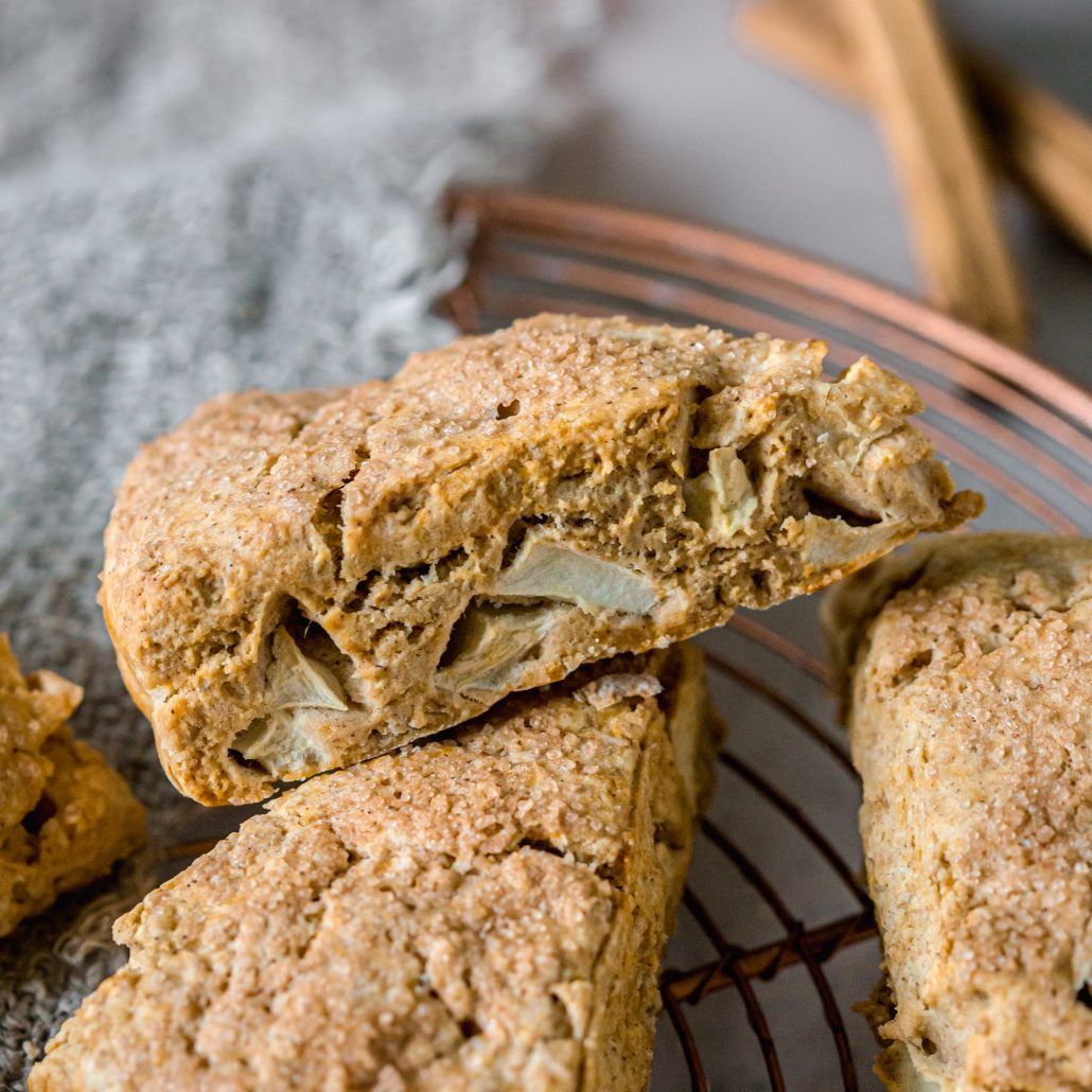 Gluten Free Apple & Cinnamon Scones! These homemade scones are heartwarming, satisfying and simple to make. Spiced with ground cinnamon, brown sugar and filled with diced apple. Serve warm shortly after the oven with a warm cup of tea.