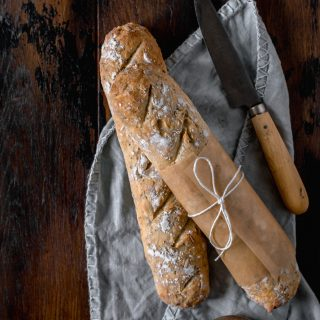 Seeded Baguettes! Homemade baguettes filled with sunflower, sesame and poppy seeds. The dough itself is simple and created in one bowl. A couple hours of resting and rising time then they're baked until golden and crisp. Serve warm straight from the oven with a dollop of butter!