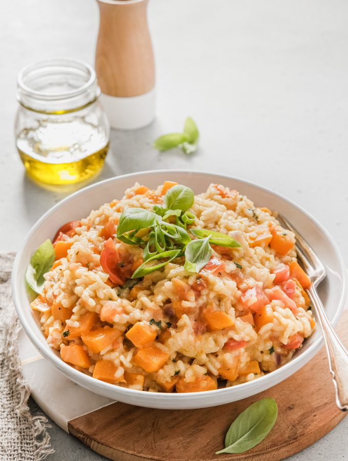 Pumpkin & Cherry Tomato Risotto! Creamy vegetarian risotto, homemade and glorious! Filled with pumpkin, bursting cherry tomatoes, spring onion and fresh basil!