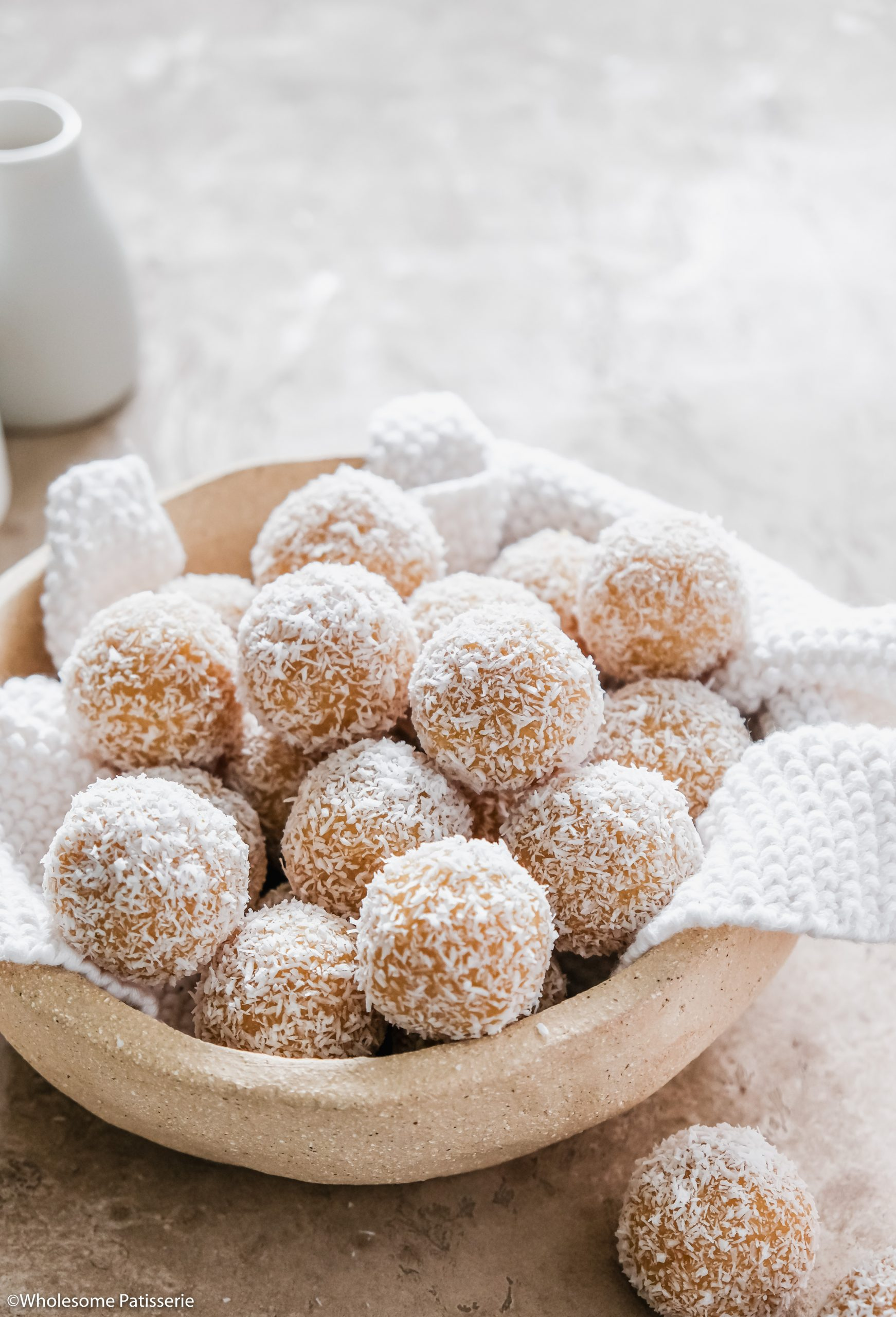 Citrus Bliss Balls! Simple homemade bliss balls infused with fresh zest and juice from lemon and orange. Sweetened with s touch of maple syrup and vanilla.