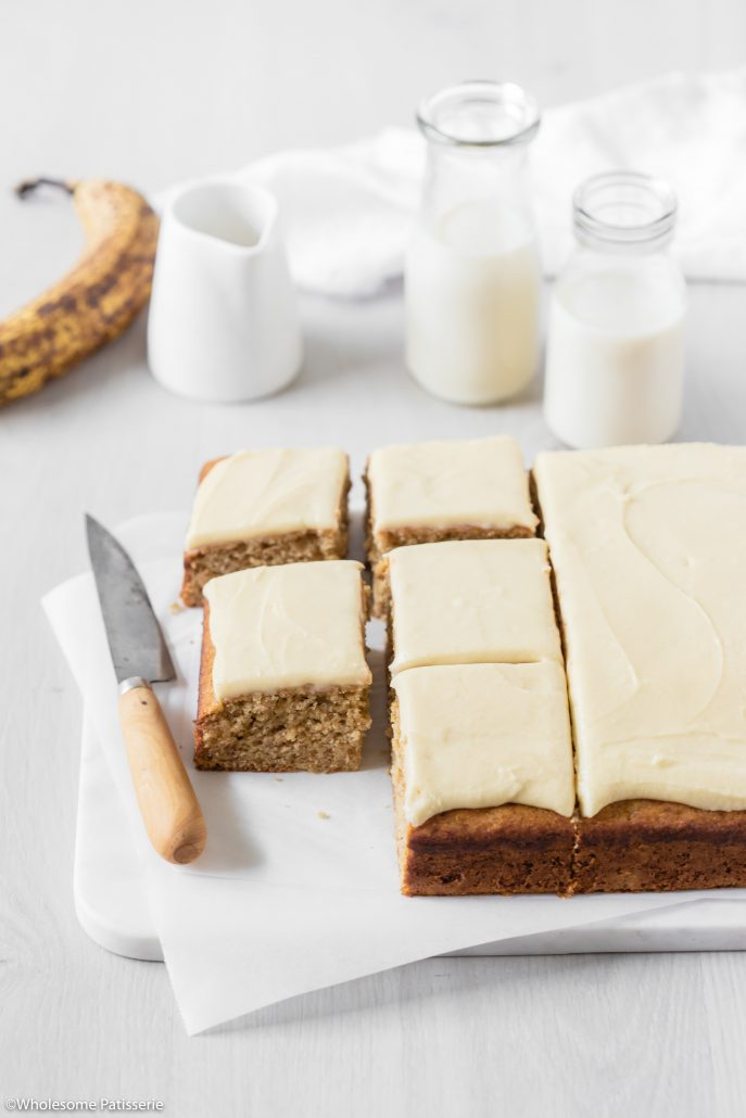 Classic Banana Cake with Vanilla Buttercream! A wonderful and classic banana sheet cake paired with a creamy and luscious vanilla infused buttercream frosting.