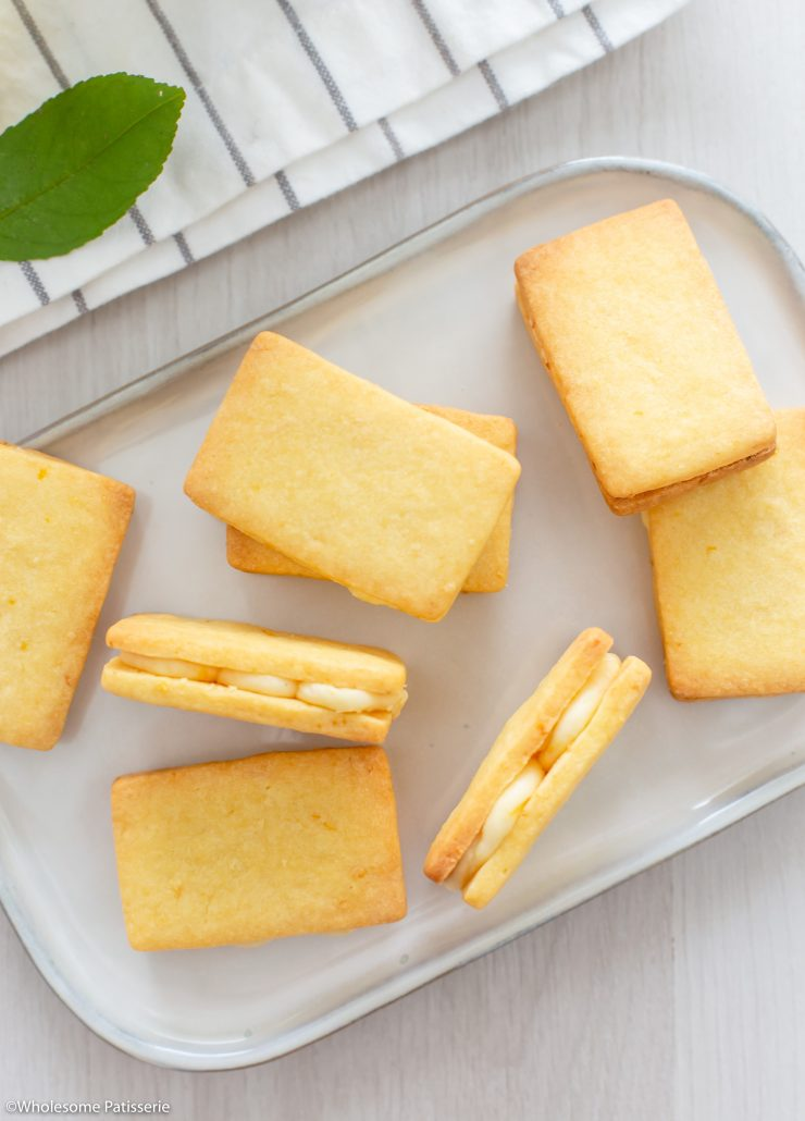 Lemon Shortbread Biscuits. Two layers of melt in your mouth shortbread biscuits filled with a zesty lemon cream. The biscuit dough is created in one bowl then cut into small rectangles and baked. The lemon filling is made with four ingredients and one bowl. Sandwich the biscuits together to create your scrumptious lemon cream shortbread biscuits.