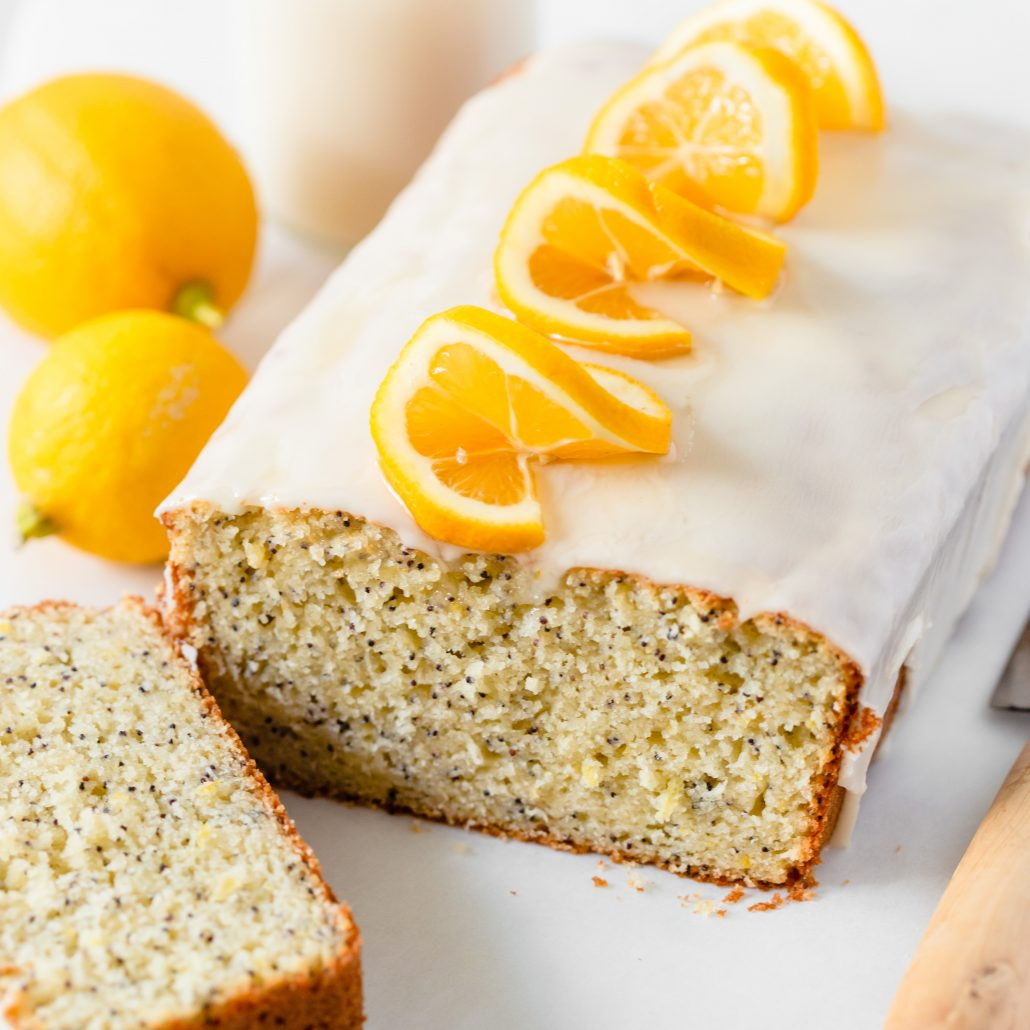 Lemon Poppy Seed Bread! A glorious classic loaf with beautiful poppy seeds that has been infused with a generous amount of grated lemon zest and freshly squeezed lemon juice. With a tender crumb yet sturdy crust, this loaf promises to offer a potent and bright lemon flavour and a slight crunch thanks to the poppy seeds. Drizzled with a 2-ingredient lemon icing which makes this bread next level scrumptious.