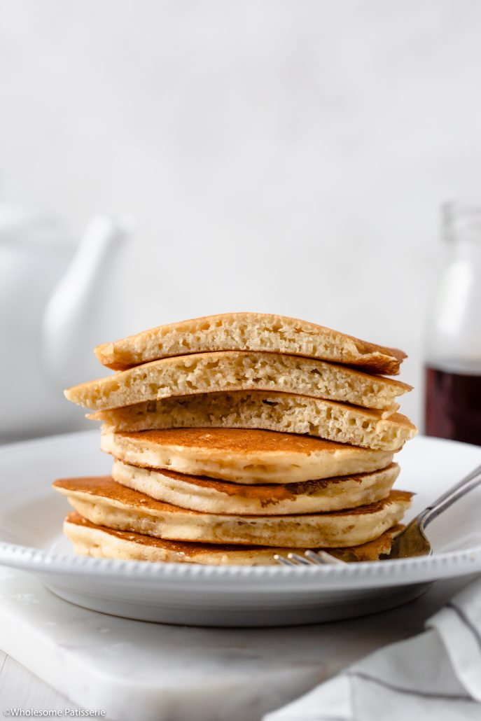 Perfect Fluffy Pancakes! A basic pancake recipe that's created in one bowl and doesn't lack flavour. Made with 8 simple ingredients, a bowl and fry pan. Infused with flavourful golden butter and plenty of vanilla bean extract to make these homemade pancakes taste amazing.