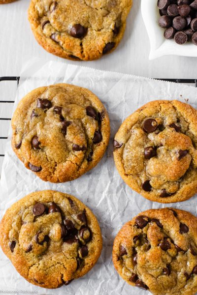 The Best Chewy Chocolate Chip Cookies! These are your ultimate bakery style, chewy and soft chocolate chip cookies. Melted butter and brown sugar promise you a chewy and gooey cookie with golden edges that offer a slight crunch. These are created in one bowl with no mixer required. Dark chocolate chips throughout for that iconic chocolate chip cookie goodness.