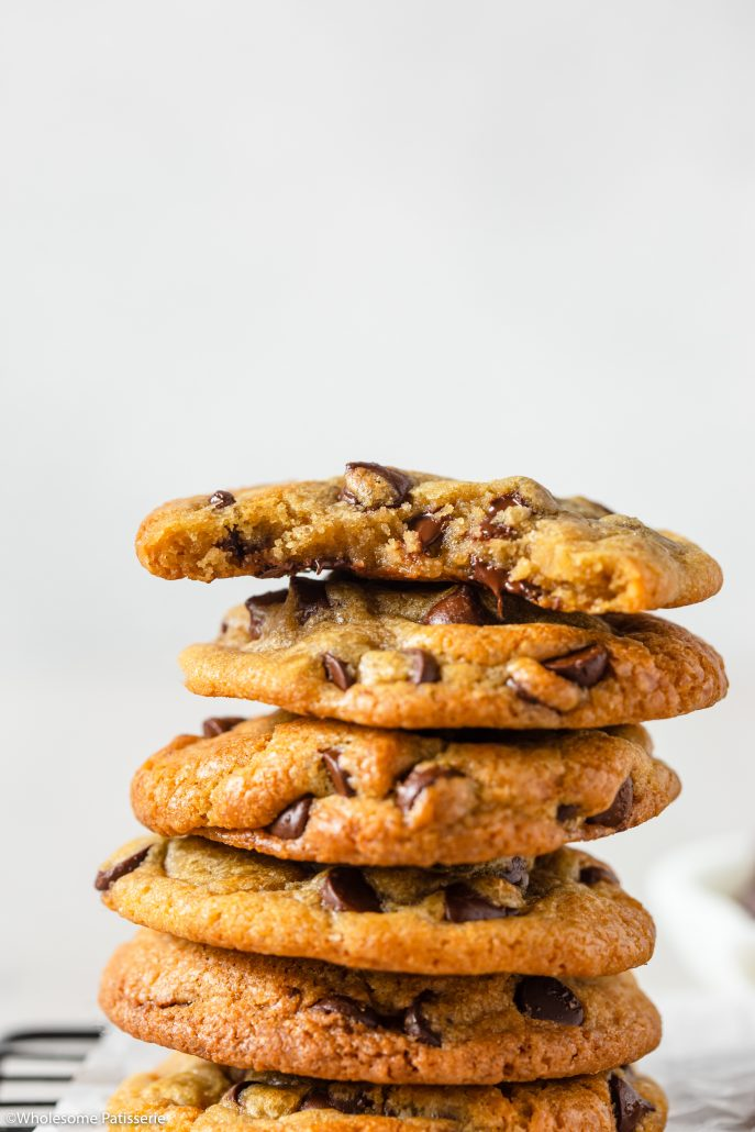 These are your ultimate bakery style, chewy and soft chocolate chip cookies. Melted butter and brown sugar promise you a chewy and gooey cookie with golden edges that offer a slight crunch. These are created in one bowl with no mixer required. Dark chocolate chips throughout for that iconic chocolate chip cookie goodness.