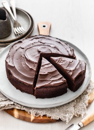 A Classic Chocolate Cake is a must have in everyones recipe repertoire. One that is rich yet not overpowering. A recipe that is simple to follow yet doesn't taste basic. This cake is all of these things and it's paired with a brilliant complementary 2-ingredient chocolate ganache frosting.