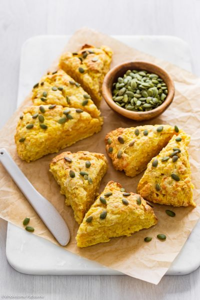 These Cheesy Pumpkin Scones have buttery flakey layers infused with grated cheese and smooth pumpkin. The combination of a crisp crust and fluffy middle makes each mouthful as delicious as the next. Sprinkled with pumpkin seeds and served warm with a spread of butter, these pumpkin scones are perfect for breakfast or afternoon tea.