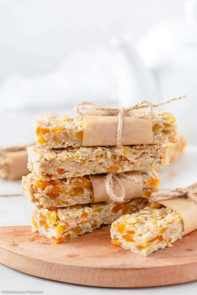 These Apricot & Tahini Healthy No Bake Granola Bars are a staple recipe to have on hand when you're needing a quick healthy snack for the week. Fabulous to pop into your kids lunchbox and also great to take to work. These granola bars require zero baking, only refrigeration. They're soft yet solid, filled with nourishing dried apricots, energising hemp seeds and nutrient dense hulled tahini created from sesame seeds.