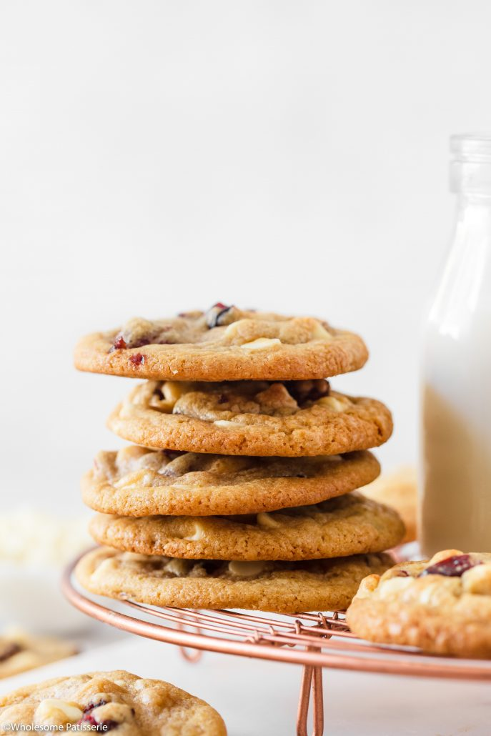 A delightful batch of Soft and Chewy Cranberry White Chocolate Chip Cookies. Perfect for your holiday season baking and a fantastic recipe to enjoy all year round. These cookies are soft and chewy in texture with a slight crisp edging. With each mouthful, you're guaranteed to get sweet and tart dried cranberries along with creamy and smooth white chocolate chips.